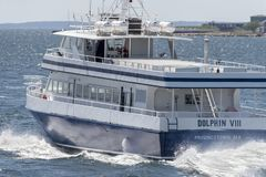 Whale watching boat Dolphin VIII heading into Buzzards Bay. Fairhaven, Massachusetts, USA - May 8, 2019: Whale watching boat Dolphin VIII heading back to home royalty free stock images