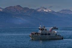Whale Watching boat. Juneau, Alaska. USA - AUG, 19, 2018. Whale watching boat looking for humpback whales in Auke Bay, Alaska stock image