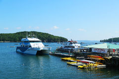 Whale watching boats and sea kayaks in historic Bar Harbor, Maine Royalty Free Stock Photos