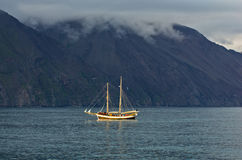 Whale watching tours from old sailing ship at Husavik bay area Stock Image