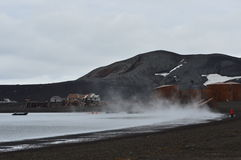 Whaler`s Bay, Antarctica. Steam rises from volcanic vents at the water`s edge. Whaler`s Bay, Deception Island, Antarctica. Dec, 2016 Stock Images