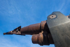 Whaling Harpoon Gun Weapon Marine Life. Whaling harpoon gun weapon . Close-up photo image of metal weapon spear head and charge cap now rusting away at maritime Stock Image