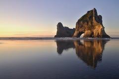 Wharariki beach. Sunset on the Wharariki beach in New Zealand Stock Photos