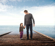 Wharf. Father and his little daughter on a wharf royalty free stock photography