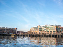 The Wharf of Baltimore. Baltimore, USA - December 27, 2014 - View of the Bond Street Wharf from the coast on a sunny winter day in Baltimore, Maryland stock image