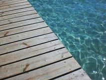 Wharf on a beautiful sea. Walking on a trasparent sea Royalty Free Stock Image