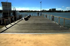Wharf with a boat and couple. A wharf on Lake Burley Griffin in Canberra royalty free stock photo