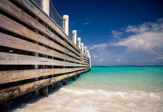 Wharf on Caribbean sea. Wooden slats of a pier in the Caribbean sea stock images