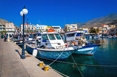 Wharf with citylights and cosy traditional Greek boats in small. Port of Pothia, Kalymnos, Greece Stock Images