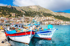 Wharf and cosy traditional Greek boats, Greece Stock Photo