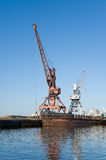 Wharf with hoisting cranes Stock Photo