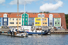 Wharf houses in Hellevoetsluis, Netherlands. Colorful facades of wharf houses and boats in the city of Hellevoetsluis, Netherlands royalty free stock image
