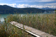 Wharf and lake. Wharf by lake Wörther See in Austria Stock Photo