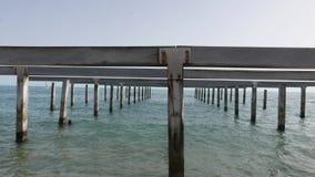 Metaphysical pier in open water sea stock video