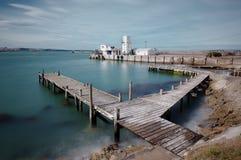 Wharf at Oamaru harbor. Timber wharf at Oamaru harbor, New Zealand Stock Image