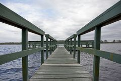 Wharf at Old Lake Davenport. A beautiful Florida day with blue sky by a green wooden wharf at Old Lake Davenport, Florida royalty free stock photography