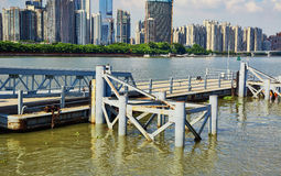 Wharf quay in city river. Wharf, quay, dock in Zhujiang River. Asian Chinese modern city view, cityscape, urban scenery and city skyline in Guangzhou City royalty free stock photos