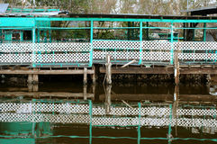 Wharf reflection. Aqua wharf reflected in Louisiana bayou at Pointe-aux-Chenes Stock Photos
