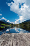 Wharf by the Schwarzsee. In Austria with mirror reflection of the landscape Stock Image