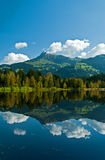 Wharf by the Schwarzsee in Austria. With mirror reflection of the landscape Royalty Free Stock Photos