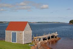 Wharf Shed. A shed at the end of a small wharf on rural Prince Edward Island Stock Image