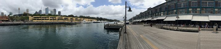 Wharf terraces building & Finger wharf separated by water at Potts Point Royalty Free Stock Images