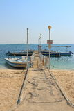 Wharf. View of the pier with moored boat. The waters of the Persian Gulf in the area of Umm al Quwain. United Arab Emirates royalty free stock photography
