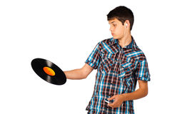 What is this?. Teenager completely clueless about a vinyl record Royalty Free Stock Photos