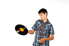 What is this?. Teenager completely clueless about a vinyl record Stock Photography