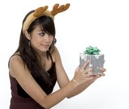 What Is It? 3. Cute Girl Wondering Whats Inside Her Present stock images
