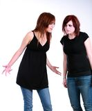 What. 2 emo girls with messy hair and makeup fighting stock photos