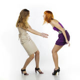 What for an awful dress?!. Two girlfriends discuss clothes stock photography