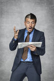 What a bad news in the newspaper. Businessman royalty free stock images