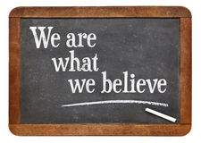 We are what believe on balckboard Royalty Free Stock Photography