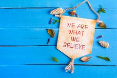 We are what we believe text on Paper Scroll royalty free stock photography