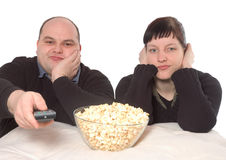 What a boring movie. Man and woman looking bored because of the bad movie Stock Image