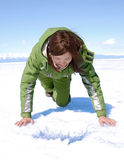 What is at the bottom of Baikal, I wonder?. Girl bending over ice hole at Baikal stock images