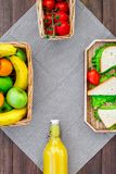 What bring for a picnic. Sanwiches, fruits, vegetables on tablecloth on dark wooden background top view copyspace Stock Photo