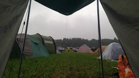 What a bummer: tent lookout during rain on a camp stock video footage
