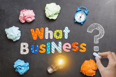 What business to start, question on blackboard with colourful letters, crumpled paper and light bulb stock photos