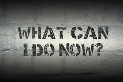 What can I do now gr. What can I do now question stencil print on the grunge white brick wall Royalty Free Stock Image