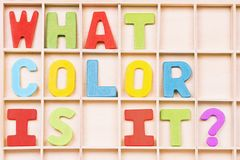 What color is it. ? text from different colors on wooden board, learning colors for kids stock image