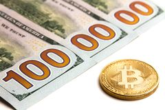 What cryptocurrency exchange rate. Gold bitcoin next to US banknotes. Three hundred dollar bills. One million dolars. White backgr. What cryptocurrency exchange Royalty Free Stock Photos
