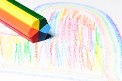 What did the crayon just do. Crayon laying on top of a drawing Royalty Free Stock Photos