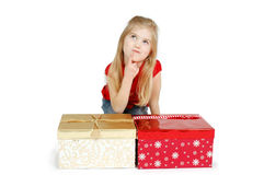What did I Get?. Little girl sits contemplating what she got for gifts in front of two wrapped boxes Stock Photography