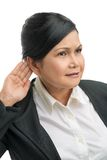 What did you say?. Senior businesswoman having problems with hearing Royalty Free Stock Photo