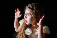 What did you say?. Girl wearing a white dress and a diadem with a gesture as she wants to hear you better Royalty Free Stock Photos
