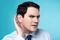 What did you say ?. Image of Businessman which overhears conversation Royalty Free Stock Image