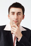 What Do You Think?. Portrait of smart young business man thinking and looking at you Royalty Free Stock Images