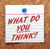 What Do You Think?. The question What Do You Think in red text on an index card pinned to a cork notice board Stock Photos
